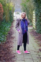 On pink sneakers in a vintage coat