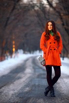 carrot orange coat - black boots - dark brown tights