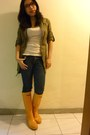 Yellow-boots-olive-green-jacket-white-top-navy-jeans