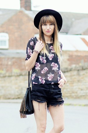 black hat - black shorts - black floral top