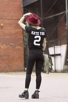 black jeans - maroon hat - black CNdirect t-shirt