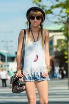 black H&M hat - black floral bag - white top