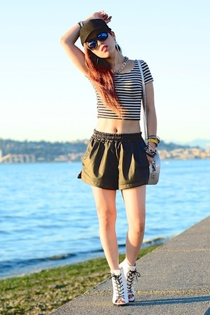 black baseball Aritzia hat - white lace-up Nasty Gal boots