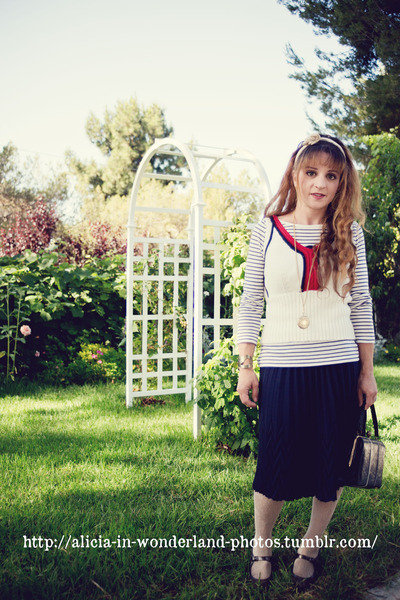 brick red sleeveless Anthropologie sweater - navy vintage purse