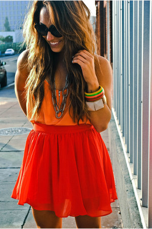 brown accessories - carrot orange top - red skirt