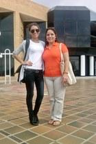 black boots - black jeans - white Zara shirt - black Aeropostale sunglasses - he