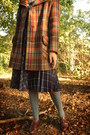 Mustard-coat-dark-brown-shoes-heather-gray-socks-navy-skirt