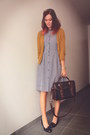 Navy-dress-dark-brown-bag-black-loafers-mustard-cardigan
