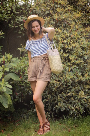 yellow hat - cream bag - light brown shorts - brown sandals - blue top