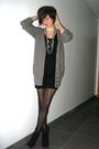Brown-cardigan-black-dress-black-boots-silver-necklace-black-tights