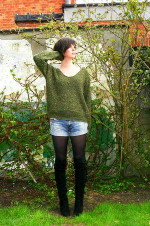 black boots - blue shorts - green sweater - black tights