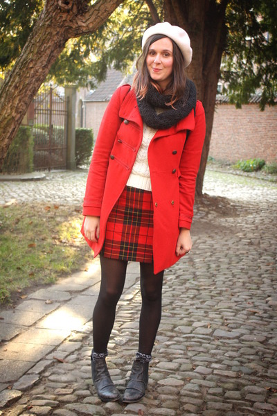 red coat - black boots - white sweater