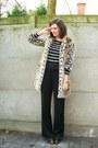 black top - black pants - tan coat - dark brown