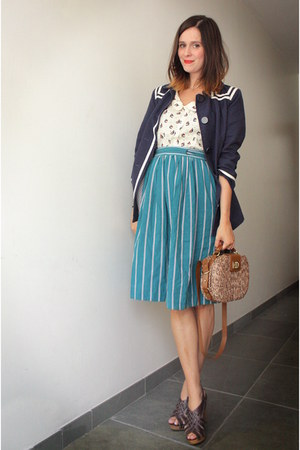 navy coat - tan bag - cream blouse - dark brown clogs - teal skirt