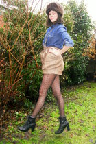 black boots - dark brown hat - navy shirt - black tights - light brown shorts -