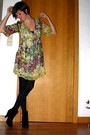 Yellow-dress-black-tights-black-boots-silver-accessories