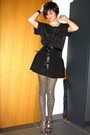Black-top-black-skirt-gold-tights-gold-shoes-black-belt
