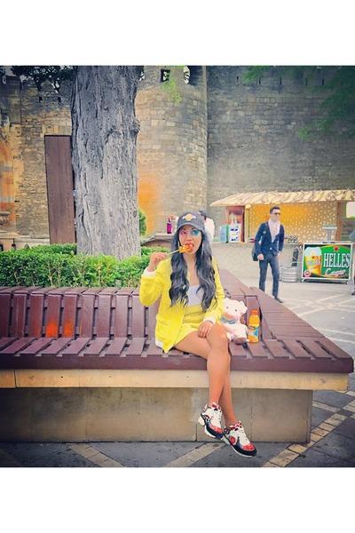 pink Chanel sneakers - black HRC hat - yellow tweed shorts Zara suit