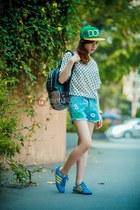 green hat - sky blue shorts - black blouse - sky blue sneakers