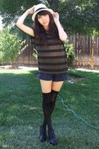 white hat - green shirt - blue shorts - black Target stockings - black shoes