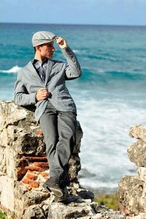 gray Levis pants - leather Aldo boots - Target hat