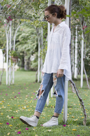 sky blue ripped Topshop jeans