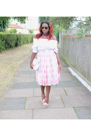 light pink midi skirt Monica B skirt - white clutch next bag