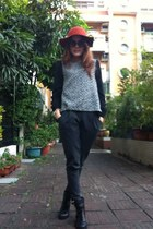 Orange hat - black boots - brown sunglasses - grey pants - black top