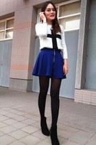 black tights - white sweater - blue skirt - silver ans bracelet - black heels