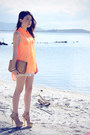 Carrot-orange-shirt-tan-bag-off-white-shorts-tan-pumps