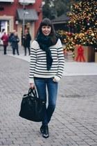 black booties Sacha shoes - navy skinny Diesel jeans