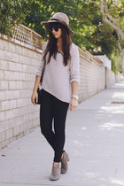 tan hat - tan booties boots - black coated jeans - beige asymmetrical sweater