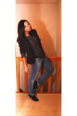 black blazer - gray shirt - blue jeans - black socks - black shoes - silver neck