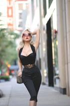 black catsuit Powderpuff pants - black clutch old bag