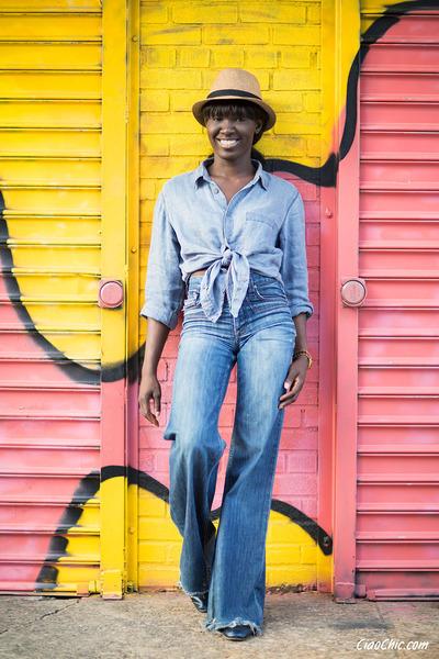 light blue linen shirt - navy denim jeans - tan straw hat