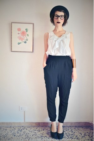 black bowler Giuliani hat - gold asos bracelet - black high-waisted H&M pants