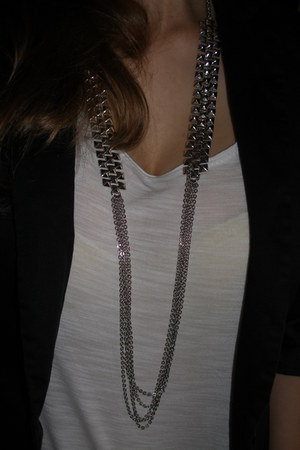 black - jacket - white - t-shirt - beige - pants - silver - necklace