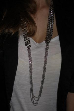 black - jacket - white - t-shirt - beige - pants - silver - necklace