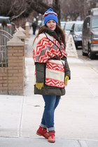olive green sleeping bag Zara coat - red studded Zara boots - periwinkle jeans