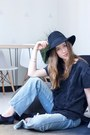 Sky-blue-flare-free-people-jeans-black-forever-21-hat-navy-free-people-top