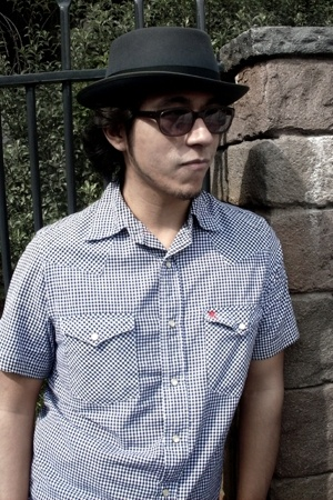 Optimo Hats hat - Moscot Eyewear glasses - American Spirit shirt