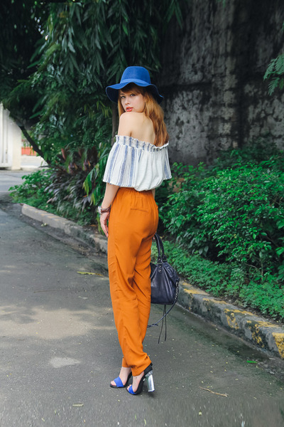 blue Stradivarius hat - navy balenciaga bag - burnt orange Sfera pants