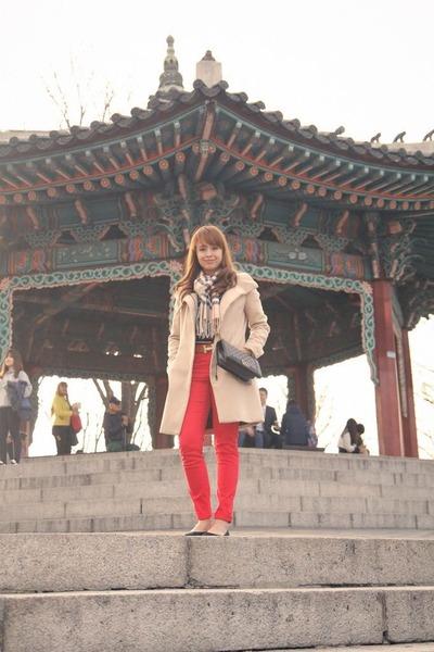 beige Stradivarius coat - brown scarf - black Chanel bag - red pants