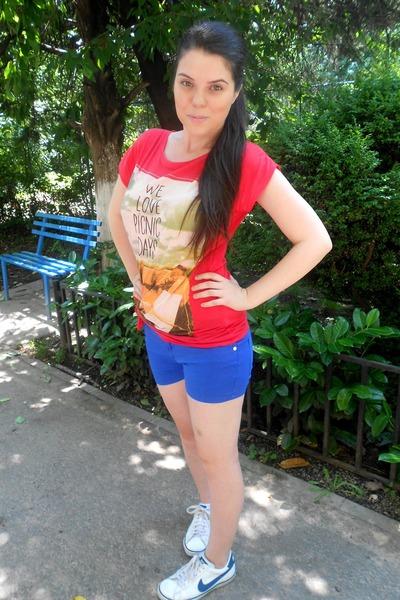 Blue Shorts Red Shirt