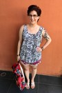 Red-from-floating-market-bag-maroon-from-market-in-patong-beach-shorts