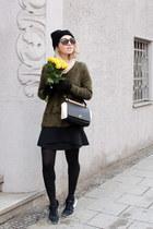 olive green H&M jumper - black trapeze Furla bag