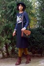 Brick-red-leather-boots-black-hat-navy-owl-printed-sweater-mustard-tights