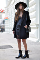 black ankle acne boots - black slip Zara dress - black oversized Mango coat