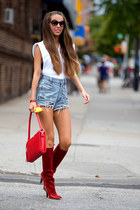 York Fashion Week - High-waisted denim shorts with red leather boots