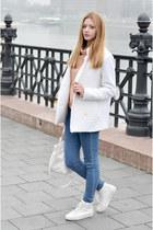 white white wool Vogos coat - navy skinny Bershka jeans - peach Nanushka sweater